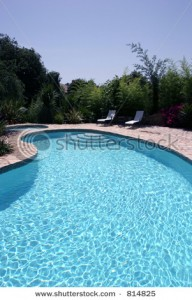 Stock photo big sunny kidney shaped swimming pool of for Kidney shaped above ground pool